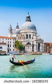 Traditional Gondola on Canal Grande with Basilica di Santa Maria della Salute in the background, Venice, Italy