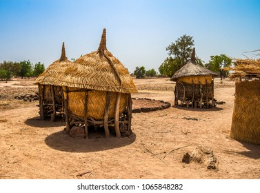 Traditional granaries made of woods and straw in an african village in Burkina Faso. They are on stilts to protect the crops against animals.