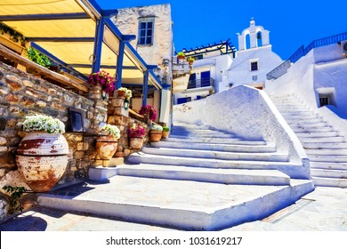 Traditional Greece - charming floral streets with tavernas, Naxos island