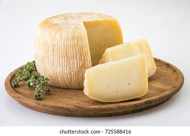 Traditional Greek cheese on wooden board.