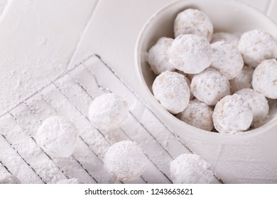 Traditional Greek Christmas cookies with almonds snowball on white background