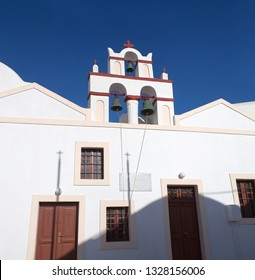 Traditional Greek Church with bell tower in Oia, Santorini island, Cyclades, Greece