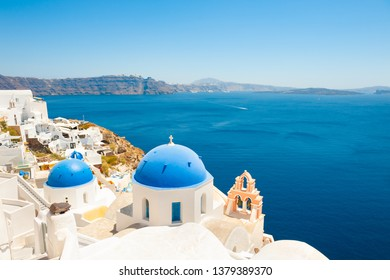 Traditional greek church and white architecture on Santorini island, Greece. Famous travel destination