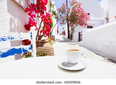 Traditional greek coffee in a cafe with beautiful mediterranean street on the background