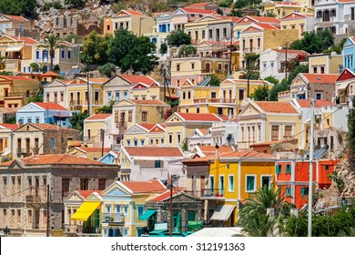 Traditional greek colorful houses in Symi island. Dodecanese, Greece.