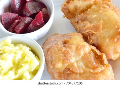 Traditional Greek dish of fried cod fish fillet, garlic dip, known as skordalia and roasted beet salad