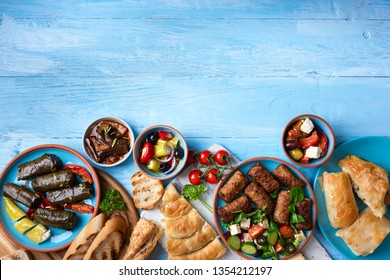 Traditional greek food on a blue wooden background.Copy space