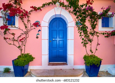 Traditional Greek House With Blue Door And Windows, Assos village in Kefalonia island, Greece
