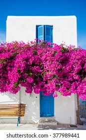 Traditional greek house with flowers in Paros island, Greece.