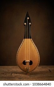 Traditional Greek instrument called Thrakian lyra on wooden background