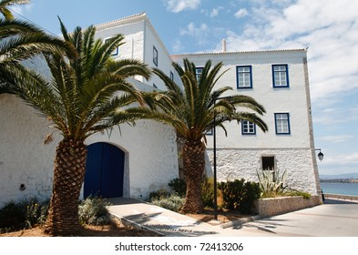Traditional Greek island house with palm-trees in Spetses, Greece