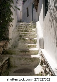 Traditional Greek narrow and winding stairs painted white