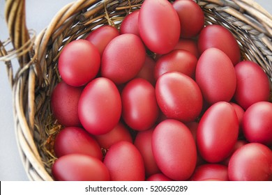 Traditional Greek Orthodox Red Dyed Easter Eggs in a Basket