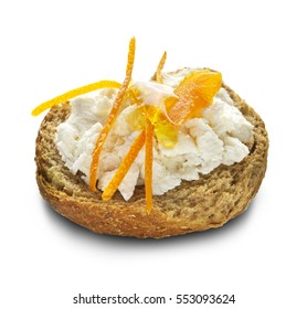 traditional Greek rusk called ntakos topped with cyprian soft cheese called anari and  sweet made of orange