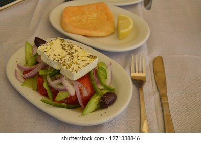 Traditional Greek salad with fried cheese Saganaki.