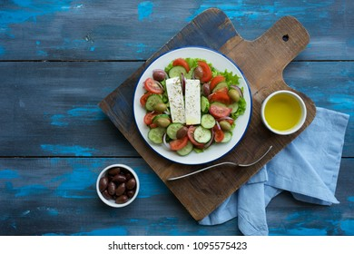 Traditional Greek salad. Light and healthy food. Blue  food background