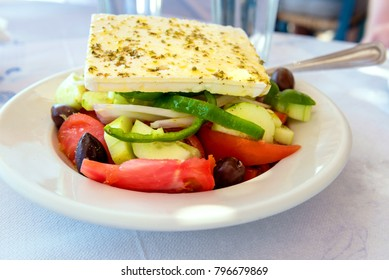 Traditional Greek salad served in Greek tavern. Naxos island. Greece.