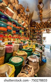 Traditional Greek shop in Naxos island, Cyclades, Greece, selling spices (written in Greek and English), baskets, ceramics