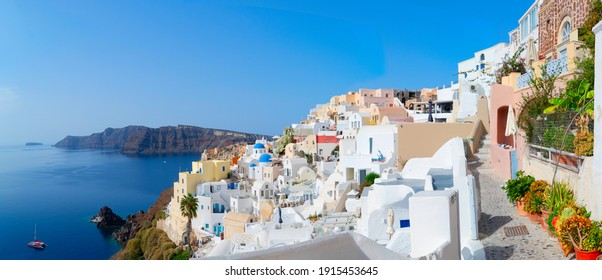 traditional greek village Oia of Santorini, street against Aegan sea and caldera, Greece, web banner format