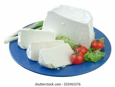 "Traditional Greek white soft cheese called ' anthotyro"" in blue plate. Clipping path."