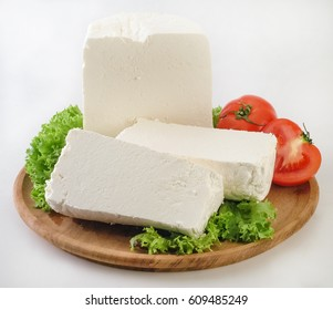 "Traditional Greek white soft cheese called ' anthotyro"" in wooden plate."