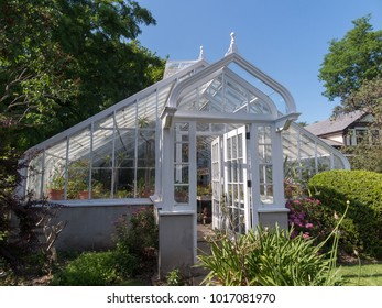 Traditional green house under blue sky