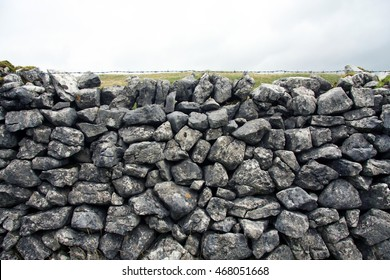 Traditional grey dry stone wall with sky, great background/texture