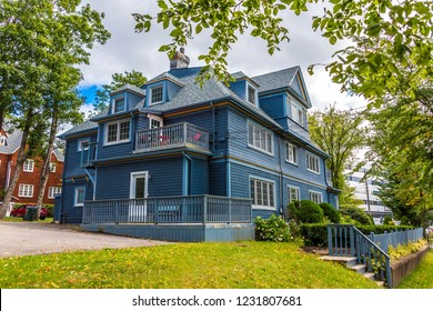 Traditional Grey Siding House in Sydney on Cape Breton Island, Nova Scotia, Canada