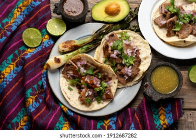 Traditional grilled beef steak tacos on wooden background. Mexican food