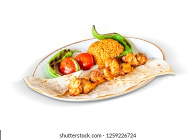 Traditional Grilled Chicken Skewers and Cracked Wheat Pilaf with Broiled Tomatoes and Peppers, White Background, with clipping path included (TR: Geleneksel Izgara Tavuk Sis ve Bulgur Pilavi)