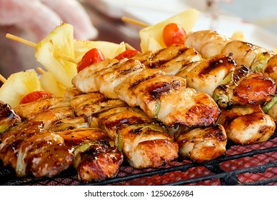 Traditional Grilled Pork and Chicken Meat Barbecue with Tomatoes and Pineapple on The Grill. One of The Most Popular Dish in The World.