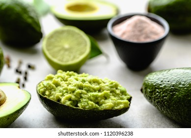Traditional guacamole dip in avocado peel, healthy food for party sharing