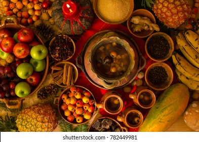 Traditional Guatemalan Hot drink (ponche) made at Christmas time, with fruits and spices on a clay pot.