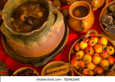 Traditional Guatemalan Hot drink (ponche) made at Christmas time, with fruits and spices, in clay crockery.