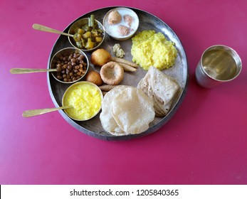 Traditional Gujarati Vegetarian food serve to Godess Amba on last of Navratri Maha Puja as religious rituals in Ahmedabad in bronze utensils.