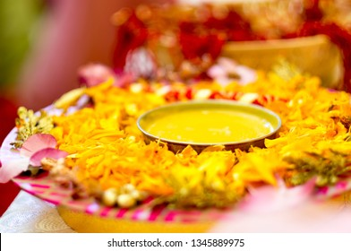 Traditional Haldi turmeric kept on a flower plate for the hindu marriage ceremony. This paste of sandal, oil and turmeric is applied by all relatives before the wedding to make the bride or groom