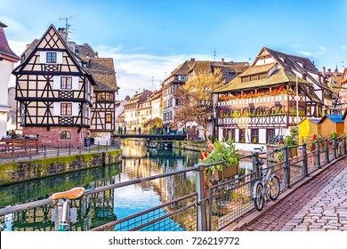 Traditional half-timbered houses on picturesque canals in La Petite France in the medieval fairytale town of Strasbourg, UNESCO World Heritage Site, Alsace, France.