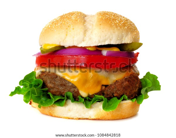 Traditional hamburger with cheese, lettuce, onion, tomato and pickle isolated on a white background