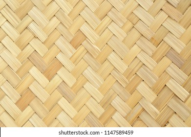 Traditional handcraft weave Thai style pattern nature background texture wicker surface for furniture material. Bamboo weaving background.