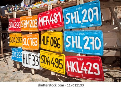 Traditional handcrafted vehicle registration plates like souvenirs for sale in Trinidad, Cuba.
