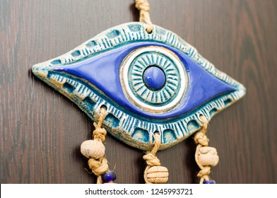 Traditional handmade evil eye talisman amulet hanged on the wall of a typical Turkish apartment