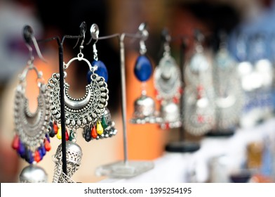 Traditional handmade jewellery in jaipur shot against a blurred background. These artificial semiprecious items are perfect accessories for ladies for events like weddings, occassions and are a