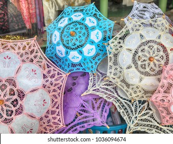 traditional handmade lace umbrellas in local souvenir shop in Lefkara, Cyprus