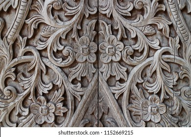 Traditional handmade teakwood carving using for door in a great mosque Kotagede entrance