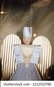 Traditional handmade tinsel angel doll so called Rauschgoldengel, made of gold foil, a festive Christmas decoration from or souvenir gift from the Christkindles Market in Nuremberg, Bavaria, Germany