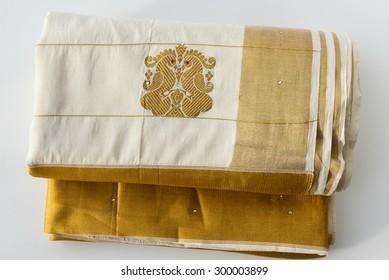 Traditional handmade white silk sari / saree with golden details, woman use to wear on Onam, Vishu festival Kerala India.