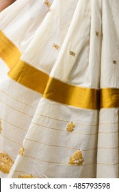 Traditional handmade white silk sari / saree with golden details, woman use to wear on Onam, Vishu festival Kerala India. pleated Kerala/set saree