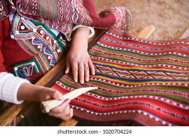 Traditional handmade wool production in Cusco Peru. Colorful alpaca clothing making factory