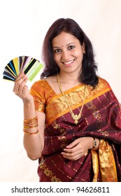 Traditional happy Indian woman holding credit and debit cards