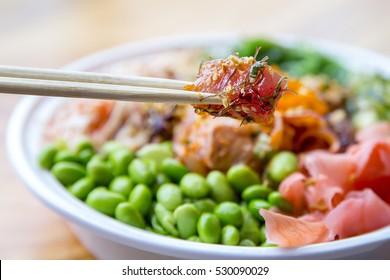 Traditional Hawaiian Ahi Poke Bowl with Seaweed, Edamame and Pink Ginger